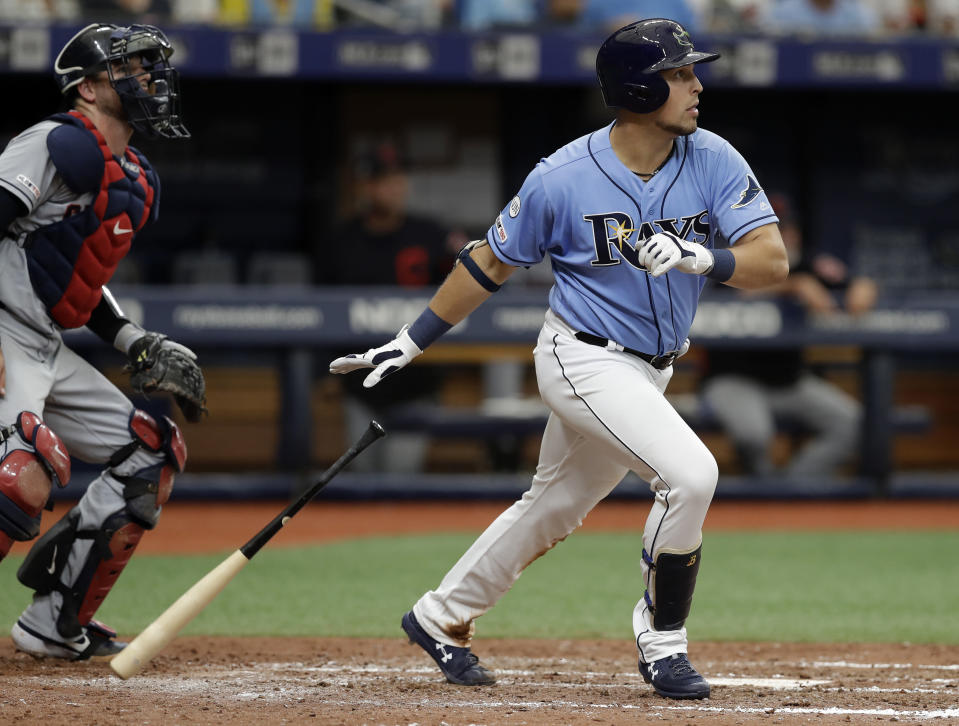 Tampa Bay Rays' Nate Lowe, right, watches his two-run home run off Cleveland Indians starting pitcher Adam Plutko during the fourth inning of a baseball game Sunday, Sept. 1, 2019, in St. Petersburg, Fla. Indians catcher Kevin Plawecki, left, looks on. (AP Photo/Chris O'Meara)