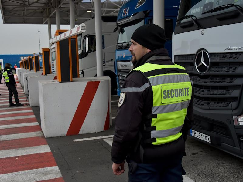A security agent controls lorries at the Coquelles Eurotunnel border post in 2019: Philippe Huguen/AFP via Getty Images