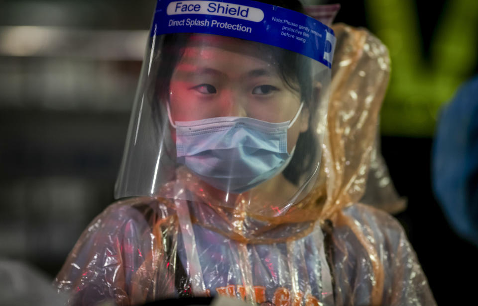 A Chinese tourist in from Shanghai, who arrived at Suvarnabhumi airport on a special tourist visa, walks, in Bangkok, Thailand, Tuesday, Oct. 20, 2020. Thailand on Tuesday took a modest step toward reviving its coronavirus-battered tourist industry by welcoming 39 visitors who flew in from Shanghai, the first such arrival since normal traveler arrivals were banned almost seven months ago. (AP Photo/Wason Wanichakorn)