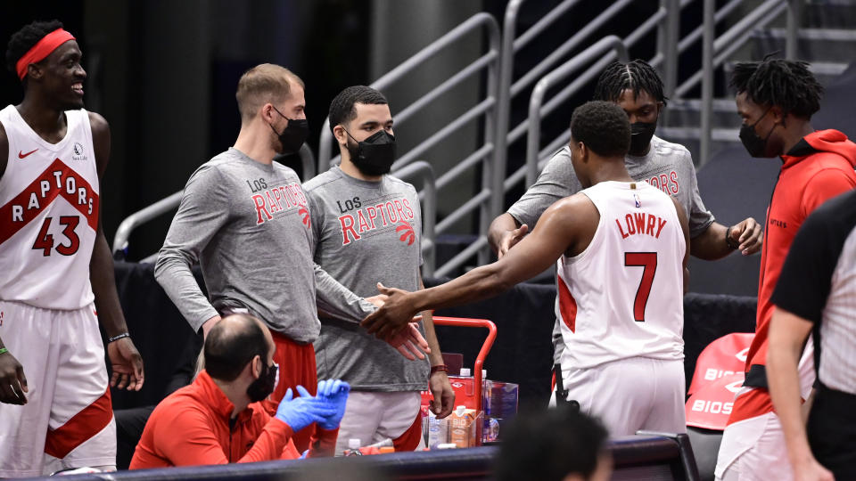 Kyle Lowry left the floor to the love of his teammates for quite possibly the final time in a Toronto Raptors jersey. (Getty)