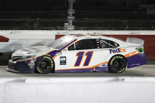 Denny Hamlin (11) drives during the NASCAR Cup Series auto race Wednesday, May 20, 2020, in Darlington, S.C. Hamlin won the race shortened by rain. (AP Photo/Brynn Anderson)