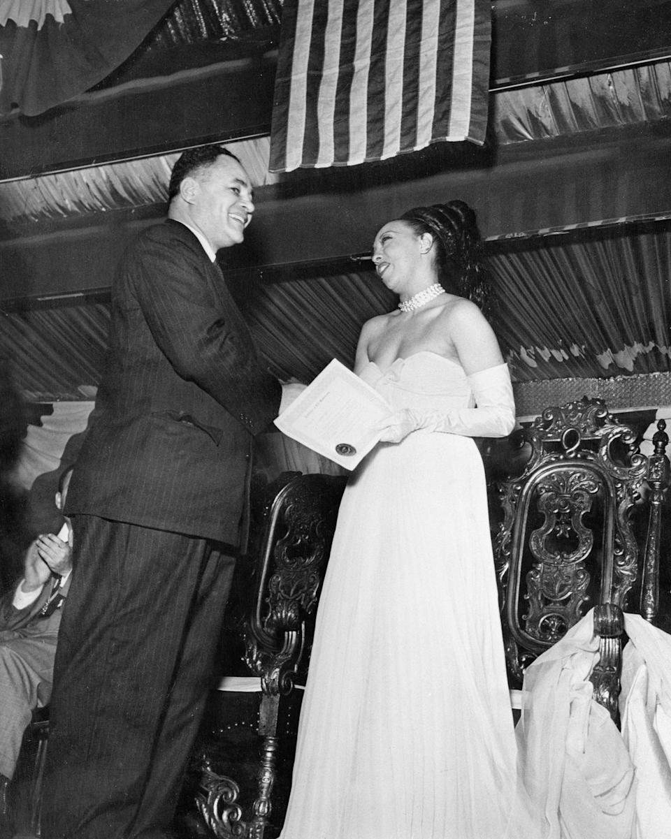 """<p>Baker was granted a lifetime membership to the NAACP for her work in civil rights advocacy in 1951. In recognition for her fight against segregation and injustice, the NAACP also <a href=""""https://www.biography.com/performer/josephine-baker"""" rel=""""nofollow noopener"""" target=""""_blank"""" data-ylk=""""slk:named May 20 Josephine Baker Day"""" class=""""link rapid-noclick-resp"""">named May 20 Josephine Baker Day</a>.</p>"""