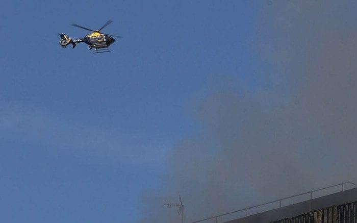 A police helicopter pictured above Grenfell Tower on the day of the fire