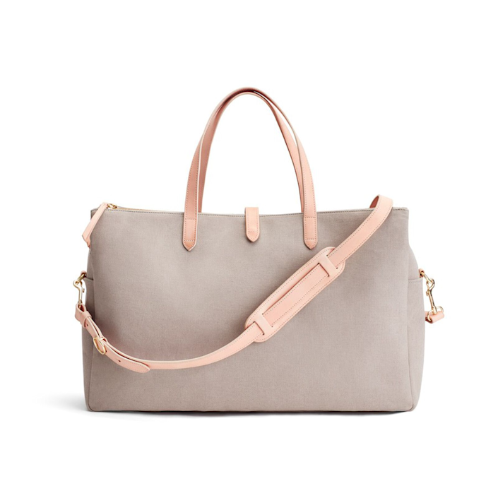 """<h3><strong>Cuyana Tripple Zipper Weekender</strong></h3><br>This Turkish canvas tote comes equipped with a roomy interior, smooth leather straps, and multiple storage pouches for containing your every casual-chic need during those long-weekend beach trips.<br><br><em>Shop <strong><a href=""""https://www.cuyana.com"""" rel=""""nofollow noopener"""" target=""""_blank"""" data-ylk=""""slk:Cuyana"""" class=""""link rapid-noclick-resp"""">Cuyana</a></strong></em><br><br><strong>Cuyana</strong> Triple Zipper Weekender, $, available at <a href=""""https://go.skimresources.com/?id=30283X879131&url=https%3A%2F%2Fwww.cuyana.com%2Fbags%2Ftravel-bags%2Ftriple-zipper-weekender%2F10010410.html"""" rel=""""nofollow noopener"""" target=""""_blank"""" data-ylk=""""slk:Cuyana"""" class=""""link rapid-noclick-resp"""">Cuyana</a>"""
