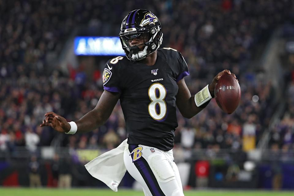 BALTIMORE, MARYLAND - NOVEMBER 03: Quarterback Lamar Jackson #8 of the Baltimore Ravens scores a first quarter touchdown  against the New England Patriots at M&T Bank Stadium on November 3, 2019 in Baltimore, Maryland. (Photo by Todd Olszewski/Getty Images)