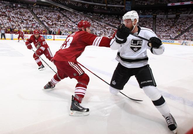 GLENDALE, AZ - MAY 15:  Derek Morris #53 of the Phoenix Coyotes plays the body on Jeff Carter #77 of the Los Angeles Kings in the first period of Game Two of the Western Conference Final during the 2012 NHL Stanley Cup Playoffs at Jobing.com Arena on May 15, 2012 in Phoenix, Arizona.  (Photo by Christian Petersen/Getty Images)