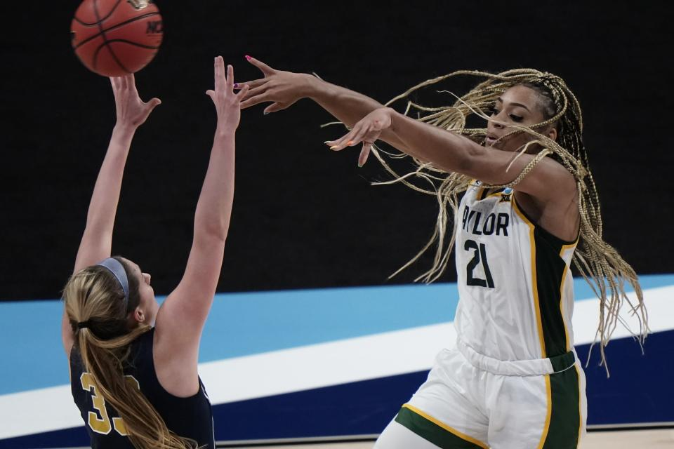 Baylor's DiJonai Carrington passes around Michigan's Emily Kiser during the second half of an NCAA college basketball game in the Sweet 16 round of the Women's NCAA tournament Saturday, March 27, 2021, at the Alamodome in San Antonio. (AP Photo/Morry Gash)