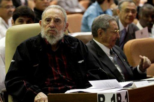 Cuban ex-president Fidel Castro (left) sits next to his brother, current president Raul, in Havana on February 24, 2013