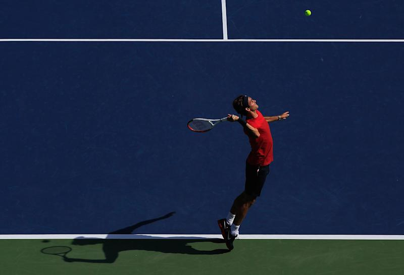 NEW YORK, NY - AUGUST 26:  Roger Federer of Switzerland serves while practicing prior to the start of the 2012 U.S. Open at the USTA Billie Jean King National Tennis Center on August 26, 2012 in the Flushing neighborhood, of the Queens borough of New York City.  (Photo by Chris Trotman/Getty Images for USTA)