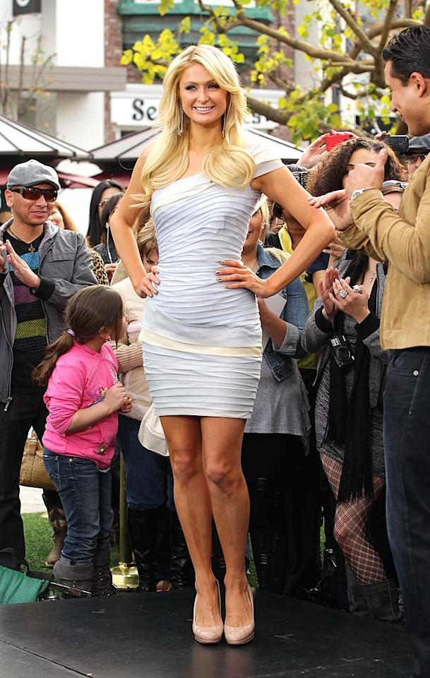 """Another fan of pleats ... socialite/entrepreneur Paris Hilton, who popped a pose in a pale blue mini, minutes before chatting with """"Extra"""" host Mario Lopez on the outdoor set of the tabloid talk show. Noel Vasquez/<a href=""""http://www.gettyimages.com/"""" target=""""new"""">GettyImages.com</a> - March 1, 2011"""