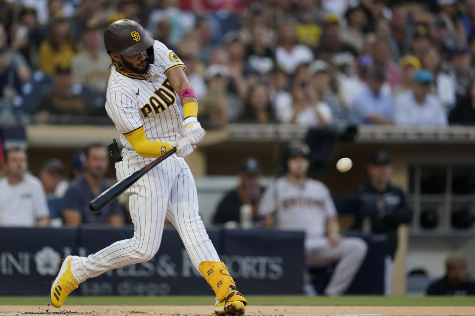 San Diego Padres' Fernando Tatis Jr., hits a home run during the first inning of a baseball game against the Arizona Diamondbacks, Friday, June 25, 2021, in San Diego. (AP Photo/Gregory Bull)