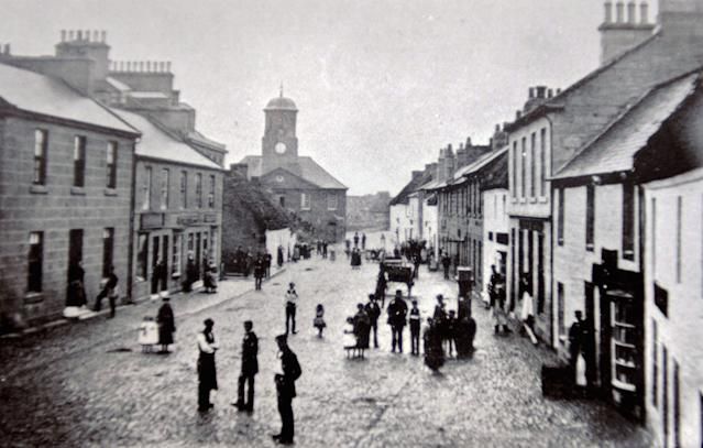 The oldest post office in the world in Sanquhar, Scotland - on the right- pictured in 1860 (Picture: SWNS)