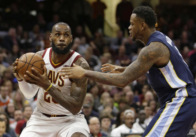 "<a class=""link rapid-noclick-resp"" href=""/nba/players/3704/"" data-ylk=""slk:LeBron James"">LeBron James</a> scored Cleveland's final 13 points to pull out a victory over the <a class=""link rapid-noclick-resp"" href=""/nba/teams/mem/"" data-ylk=""slk:Memphis Grizzlies"">Memphis Grizzlies</a> but that may have just been so he could catch the end of Ohio State's game. (AP Photo)"