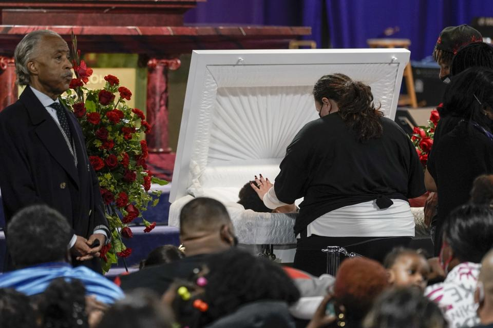 Katie Wright, mother of Daunte Wright, places her hand on her son during visitation, Wednesday, April 21, 2021, in Minneapolis. Daunte Wright was fatally shot by a police officer during a traffic stop. (AP Photo/Morry Gash)