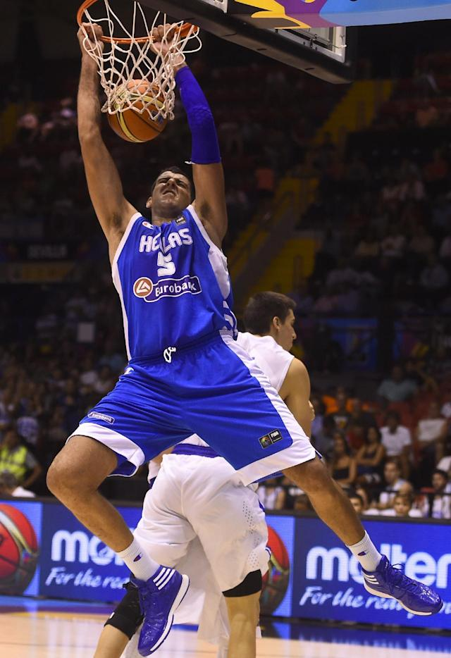 Greece's centre Giannis Bourousis scores during the 2014 FIBA World basketball championships in Sevilla on September 1, 2014 (AFP Photo/Pierre-Philippe Marcou)