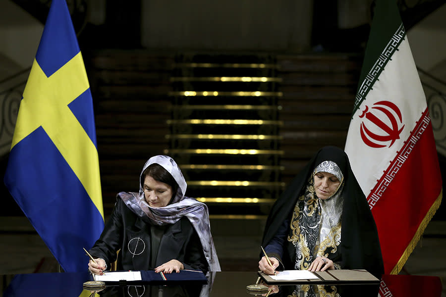 """<p>In February 2017, Ann Linde, left, Sweden's minister for EU affairs and trade (seated next to Shahindokht Molaverdi, Iran's vice president for women and family affairs), wore a hijab during a visit to Iran — along with many others in the Swedish delegation — despite being self-described feminists. Hillel Neuer, executive director of human rights group U.N. Watch, <a rel=""""nofollow noopener"""" href=""""https://www.washingtonpost.com/news/worldviews/wp/2017/02/13/swedens-feminist-government-criticized-for-wearing-headscarves-in-iran/?utm_term=.247608e51ab0"""" target=""""_blank"""" data-ylk=""""slk:pointed it out in a tweet"""" class=""""link rapid-noclick-resp"""">pointed it out in a tweet</a>, calling it a """"shame."""" Anti-hijab activist Masih Alinejad agreed, noting <a rel=""""nofollow noopener"""" href=""""https://www.facebook.com/StealthyFreedom/videos/1678158298864924/"""" target=""""_blank"""" data-ylk=""""slk:on Facebook"""" class=""""link rapid-noclick-resp"""">on Facebook</a>, """"By actually complying with the directives of the Islamic Republic, Western women legitimize the compulsory hijab law."""" (Photo: AP Images) </p>"""