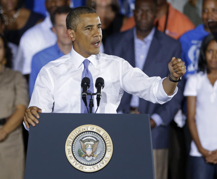 President Barack Obama gestures as he speaks about the economy, Thursday, July 25, 2013, at the Jacksonville Port Authority in Jacksonville, Fla. A day after he kicked off the tour in Illinois and Missouri, Obama was traveling Thursday to a seaport in Jacksonville, Fla., to yet again deride the wide gulf between his vision for a new American prosperity driven by a burgeoning middle class and the intense gridlock snarling up Congress. (AP Photo/John Raoux)