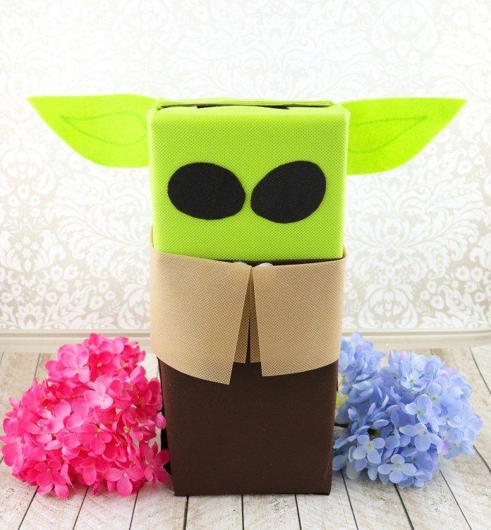 """<p>Here's another cutie for the <em>Star Wars</em> fan in your family. Baby Yoda is just waiting to collect all your Valentines!</p><p><strong>Get the tutorial at</strong> <strong><a href=""""https://www.morenascorner.com/2020/01/baby-yoda-valentine.html"""" rel=""""nofollow noopener"""" target=""""_blank"""" data-ylk=""""slk:Morena's Corner."""" class=""""link rapid-noclick-resp"""">Morena's Corner.</a></strong></p><p><a class=""""link rapid-noclick-resp"""" href=""""https://www.amazon.com/Fairfield-Multi-Purpose-20-Inch-Material-3-Yard/dp/B00KKV71BK/?tag=syn-yahoo-20&ascsubtag=%5Bartid%7C2164.g.35119968%5Bsrc%7Cyahoo-us"""" rel=""""nofollow noopener"""" target=""""_blank"""" data-ylk=""""slk:SHOP CRAFT FABRIC"""">SHOP CRAFT FABRIC</a></p>"""