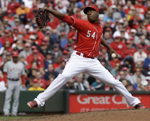 Cincinnati Reds relief pitcher Aroldis Chapman throws against the Los Angeles Angels during the ninth inning of an interleague baseball game, Thursday, April 4, 2013, in Cincinnati. Chapman earned his first save of the season as the Red 5-4 win. (AP Photo/Al Behrman)