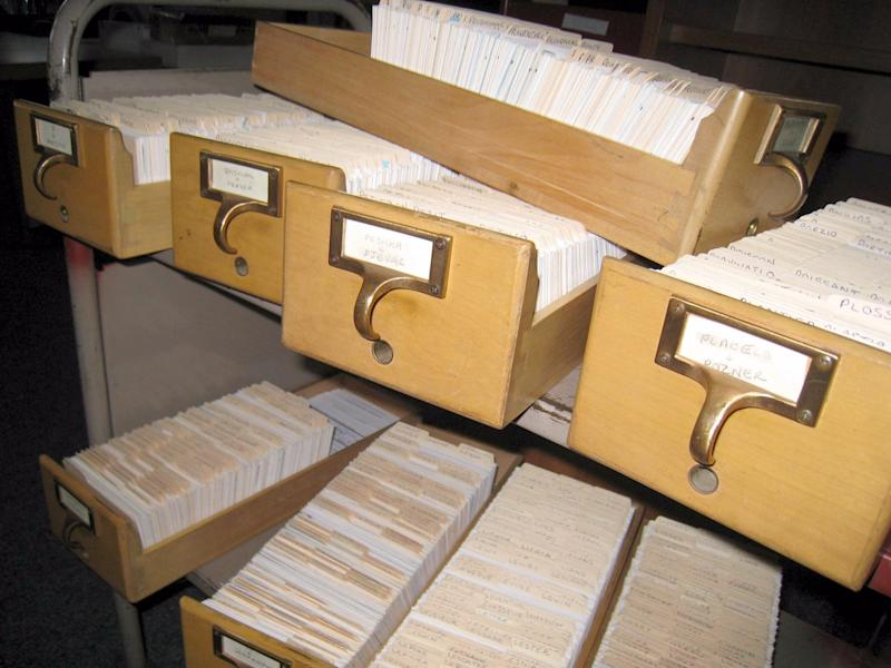 filing cabinet files documents mess office