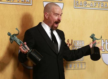"""Actor Bryan Cranston poses backstage with his awards for outstanding male actor in a drama series for """"Breaking Bad"""" and for outstanding cast in a motion picture for """"Argo"""" at the 19th annual Screen Actors Guild Awards in Los Angeles, California January 27, 2013. REUTERS/Adrees Latif"""