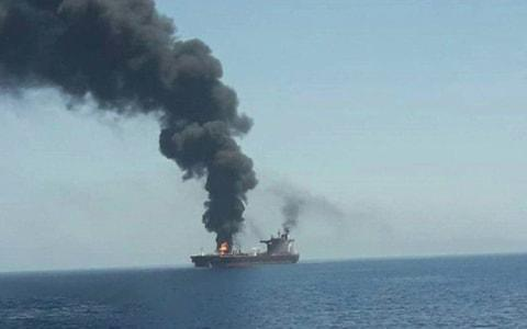 <span>A fire on one of the two carriers in the Gulf of Oman</span> <span>Credit: Al Hadath </span>