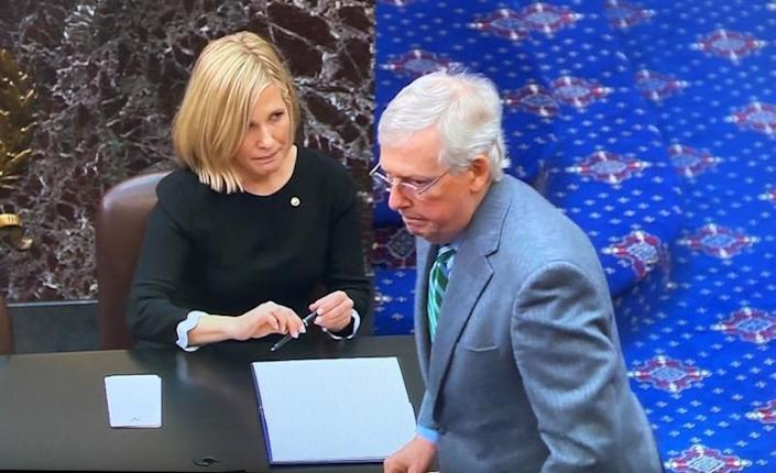 Senate Majority Leader McConnell signs oath book at start of Senate impeachment trial of President Trump at the U.S. Capitol in Washington