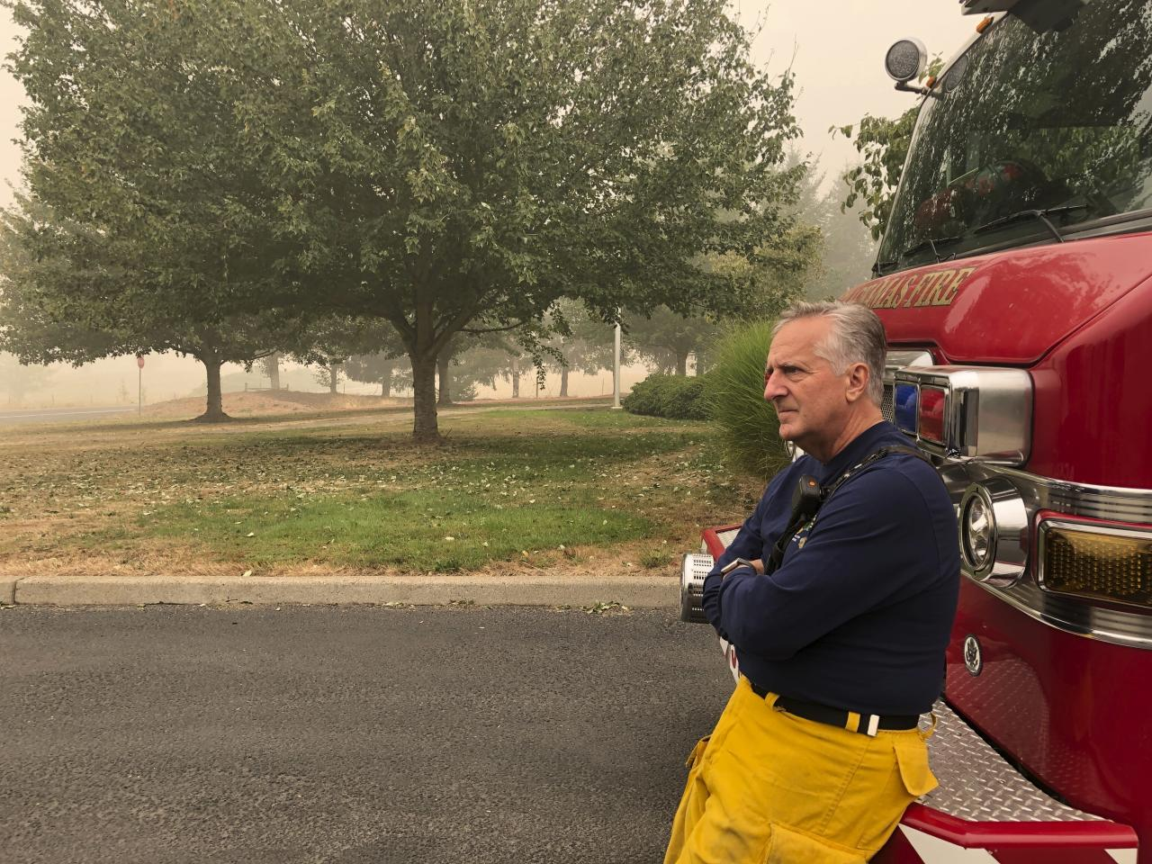 Firefighters battle exhaustion along with wildfire flames