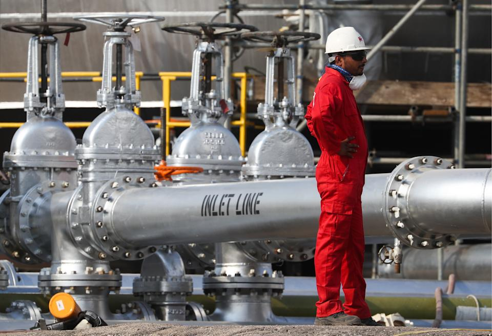 EASTERN PROVINCE, SAUDI ARABIA - OCTOBER 12, 2019: A worker at an oil processing facility of Saudi Aramco, a Saudi Arabian state-owned oil and gas company, at the Abqaiq oil field. On 14 September 2019, two of the major Saudi oil facilities, Abqaiq and Khurais, suffered massive attacks of explosive-laden drones and cruise missiles; the Houthi movement, also known as Ansar Allah, claimed responsibility for the attacks. Stanislav Krasilnikov/TASS (Photo by Stanislav Krasilnikov\TASS via Getty Images)