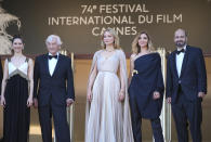 Daphne Patakia, from left, director Paul Verhoeven, Virginie Efira, Clotilde Courau, and David Birke pose for photographers upon arrival at the premiere of the film 'Benedetta' at the 74th international film festival, Cannes, southern France, Friday, July 9, 2021. (AP Photo/Vadim Ghirda)