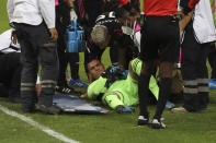 Mexico's goalkeeper Luis Malagon lies on the pitch in pain during a Concacaf Men's Olympic Qualifying championship soccer match against United States in Guadalajara, Mexico, Wednesday, March 24, 2021. (AP Photo/Fernando Llano)