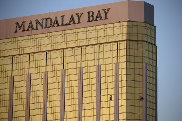 Drapes billow out of broken windows on the 32nd floor of the Mandalay Bay Resort and Casino. (Photo: John Locher/AP)