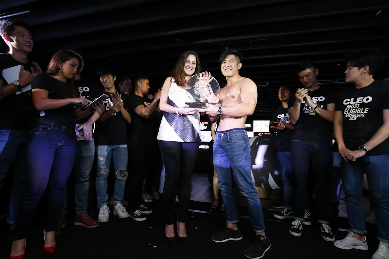 <p>CLEO editor-in-chief Claire Starkey poses for a picture with Ng Zi Xuan, winner of CLEO Most Eligible Bachelors 2018. (PHOTO: CLEO) </p>