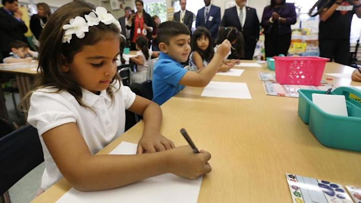 "First grade student Isabella Tahmasian writes her name with fellow classmates on the first day of school for LAUSD in 2017. The Los Angeles Unified School District and United Teachers Los Angeles agreed upon a deal for online learning just before the first day of school on Aug. 18. <span class=""copyright"">(Al Seib / Los Angeles Times)</span>"