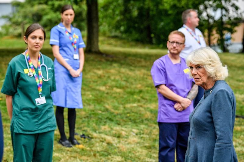 The Duchess of Cornwall chats with NHS staff and front line key workers who who have responded to the COVID-19 pandemic during a visit to Gloucestershire Royal Hospital. (Photo by Ben Birchall/PA Images via Getty Images)