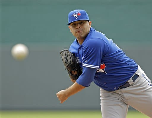 Toronto Blue Jays starting pitcher Ricky Romero throws during the first inning of a baseball game against the Kansas City Royals, Sunday, April 22, 2012, in Kansas City, Mo. (AP Photo/Charlie Riedel)