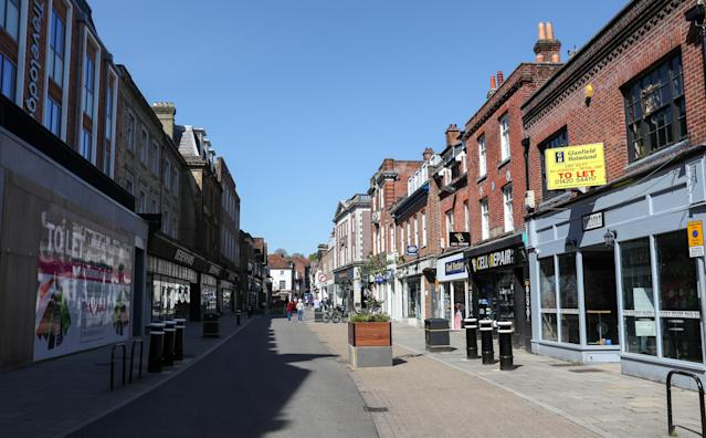 People walk along a near empty High Street in Winchester, as the UK continues in lockdown to help curb the spread of the coronavirus. (PA)