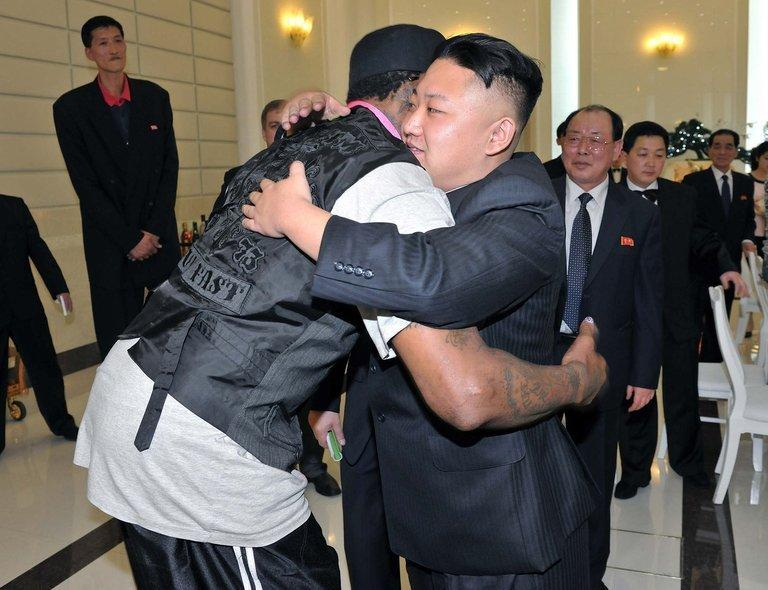 Kim Jong-Un (right) hugs Dennis Rodman (left) at a dinner in Pyongyang last night. The Swiss-educated Kim, believed to be in his late 20s, is reported to be a huge fan of basketball and the Chicago Bulls, with whom Rodman won three NBA titles alongside Michael Jordan in the 1990s