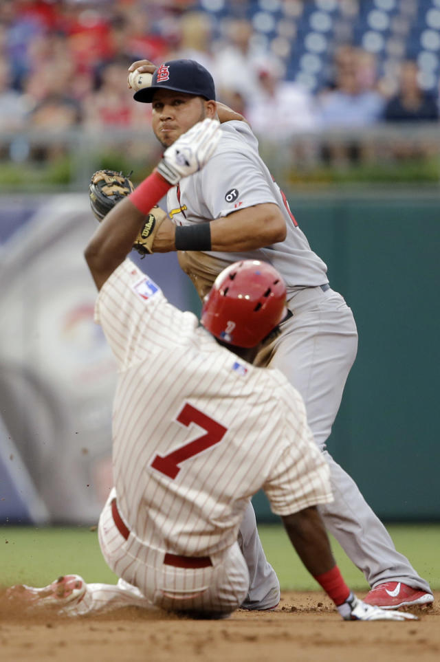 St. Louis Cardinals shortstop Jhonny Peralta, top, throws to first base after forcing out Philadelphia Phillies' Maikel Franco at second on a double play hit into by Ryan Howard during the first inning of a baseball game, Friday, June 19, 2015, in Philadelphia. Howard was out at first on the play. (AP Photo/Matt Slocum)