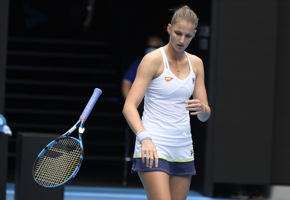 Karolina Pliskova of the Czech Republic throws her racket in frustration during her third round match against compatriot Karolina Muchova at the Australian Open tennis championship in Melbourne, Australia, Saturday, Feb. 13, 2021.(AP Photo/Andy Brownbill)