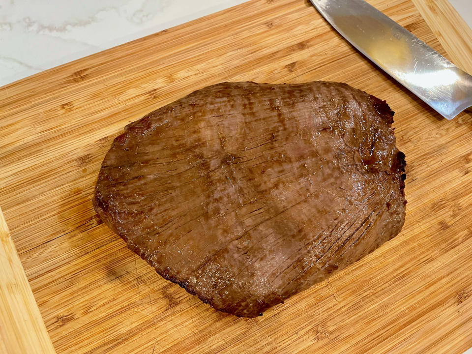 If you're looking for ease when cooking flank steak, turn to your broiler. For optimal browning, turn to your grill. (Ali Rosen)