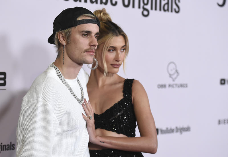 "Justin Bieber and Hailey Baldwin arrive at the Los Angeles premiere of ""Justin Bieber: Seasons"" on Monday, Jan. 27, 2020. (Photo by Jordan Strauss/Invision/AP)"