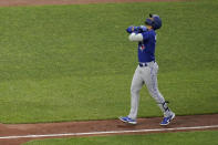 Toronto Blue Jays' Lourdes Gurriel Jr. gestures while running the bases after hitting a solo home run off Baltimore Orioles starting pitcher Thomas Eshelman during the fifth inning of a baseball game, Friday, June 18, 2021, in Baltimore. (AP Photo/Julio Cortez)