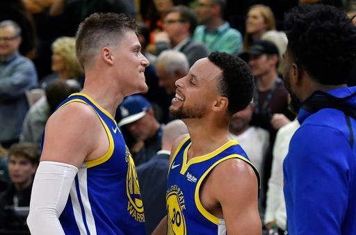 SALT LAKE CITY, UT - OCTOBER 19: Jonas Jerebko #21 of the Golden State Warriors and teammate Stephen Curry #30 react to their 124-123 win over the Utah Jazz at the end of a NBA game at Vivint Smart Home Arena on October 19, 2018 in Salt Lake City, Utah. Jerebko had the winning basket. (Photo by Gene Sweeney Jr./Getty Images)