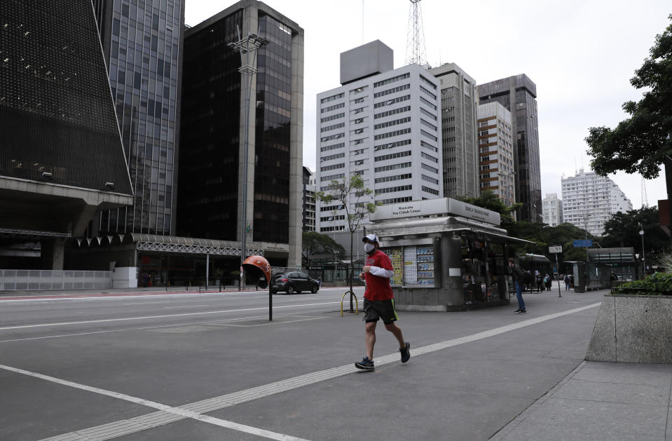 SAO PAULO, BRAZIL - APRIL 17: A man runs at Paulista avenue wearing a protective mask amidst the Coronavirus (COVID - 19) pandemic on April 17, 2020 in Sao Paulo, Brazil. According to the Ministry  of health, Brazil has 33,682 confirmed cases infected with coronavirus (COVID-19) and at least 2,141 recorded deceases.(Photo by Rodrigo Paiva/Getty Images)