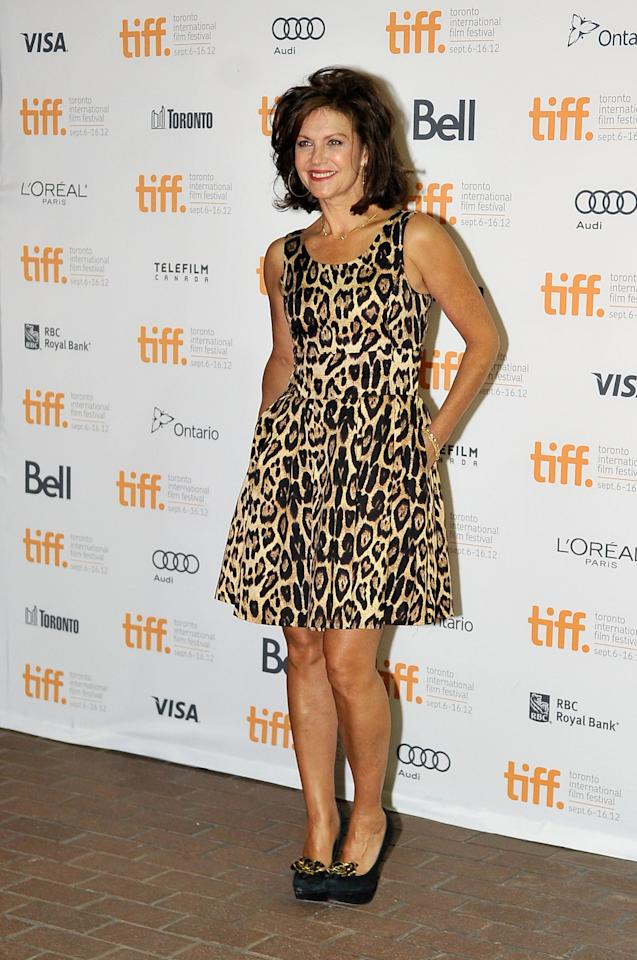 """WORST: We're sure """"Saving Hope"""" star Wendy Crewson was going for """"casually tousled and care-free"""" with that hair, but it comes off as messy and much too big. Add to that the unfortunately leopard print dress (which may have worked if it were cut with a more flattering neckline) and the gold lamé flowers on her shoes, and this entire look is just one big miss."""