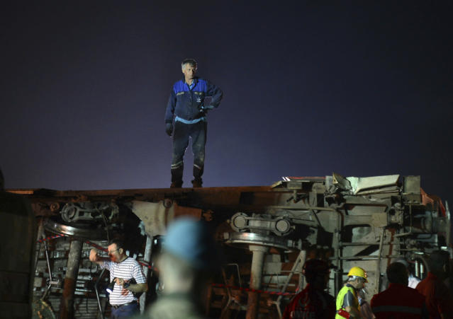 <p>Recovery officials work around overturned train cars, near a village at Tekirdag province, northwestern Turkey on July 9, 2018. (Photo: IHA via AP) </p>