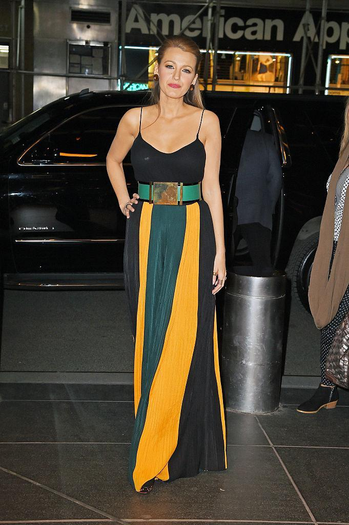 <p>We're a huge fan of Blake's colour block Balmain trousers and wide belt combo here.<br><i>[Photo: Getty]</i> </p>