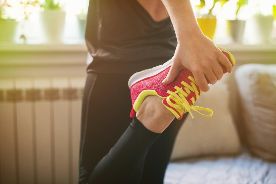 Young woman getting ready for morning exercising