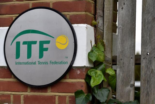 FILE PHOTO: A logo is seen at the entrance to the International Tennis Federation headquarters in London